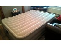 Intex queen size inflatable bed with built in pump