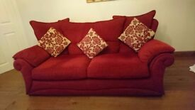 Red fabric sofa and chairs