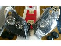 VAUXHALL ASTRA H MK5 04-07 BLACK INNER HEADLIGHTS HEADLAMPS PAIR LEFT & RIGHT