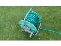 Garden Hose and Hose Reel Winder.