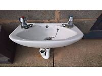 Small cloakroom sink with taps
