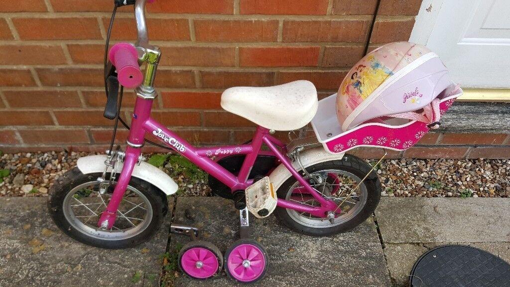 Girls first bike with princess helmet