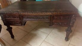 Heavey carved table