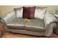 Large 2 seater and 2 swivel chairs.(new)