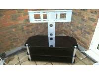 Tv hanging stand