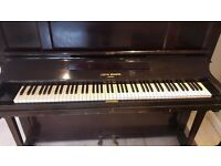 Beautiful Justin Brown upright piano that needs a good home, needs a polish and a tune