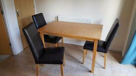 Wooden table and 3 matching chairs.