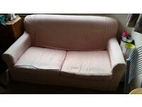 Two-seater couch, fold out sofa bed