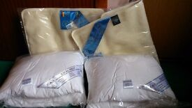 2 white washable vacuum packed pillows plus 2 Icelandic Wool anti allergenic pillow covers