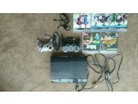 PS3 Super Slim 500GB for sale with 2x controllers, Headset and 8 Games