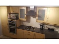Complete used kitchen for sale comprises cabinets, breakfast bar, worktops and appliances