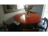 Vintage teak dining tabke and four padded chairs