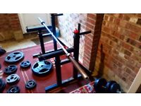 HOME GYM. Olympic barbell, plates, squat rack, bench and dumbbells