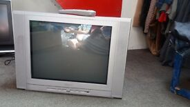 TV. Old, heavy but in working order.