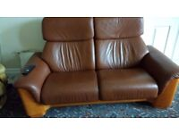 Stressless tan leather 2 seater reclining sofa.