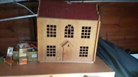 Wooden dolls house and tin of dolls furniture
