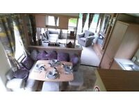 This static Caravan has beautiful lounge sofas and dinning room furniture