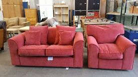 Red velour two seater sofa bed with matching armchair