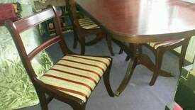 Dining table with four chairs and Ralph Lauren table cover