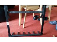 Black guitar stand for 5 guitars. Folds flat .