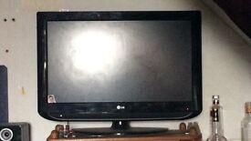 Black LG TV no remote but works fine