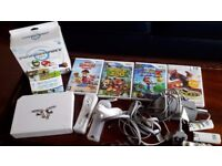 Nintendo Wii console and 5 games for sale