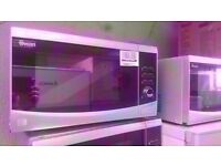 New condition Silver 23 Liter Touch Control Microwave R.R.P. £99.99 Now £59