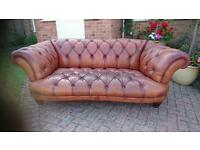 An Oskar leather Chesterfield sofa