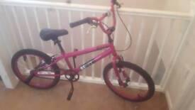 Nearly new girls 20 inch BMX bike bicycle with stunt pegs