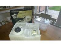 Tommee Tippee electric breast pump plus milk storage bags.