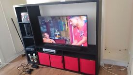 For sale black tv unit large. Great condition. Small dent on side but not noticeable.