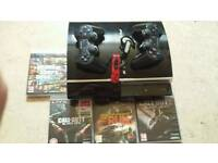 Ps3 with games 3 pads 2 ear peices