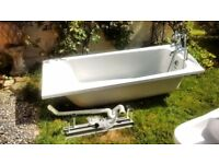 Bath with panels and mixer tap/shower