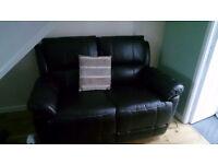 dark brown 2 seater recliner sofa, reclines to lye down