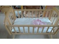 Rocking crib hardly used plus mattress and two fitted sheets