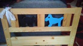 Toddler Bed frame. cat and dog metal shapes.