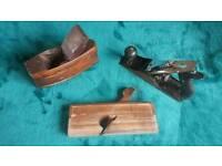 Wooden planes plus a metal plane