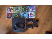 PS3 console, 3 controllers and a bundle of games