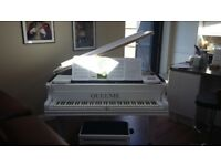 Beautiful gloss white wrapped baby grand piano, Excellent condition.
