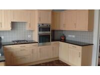 Kitchen units with granite tops