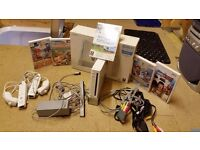 Wii console - Includes 2 x controllers, nunchucks and leads and 5 x games