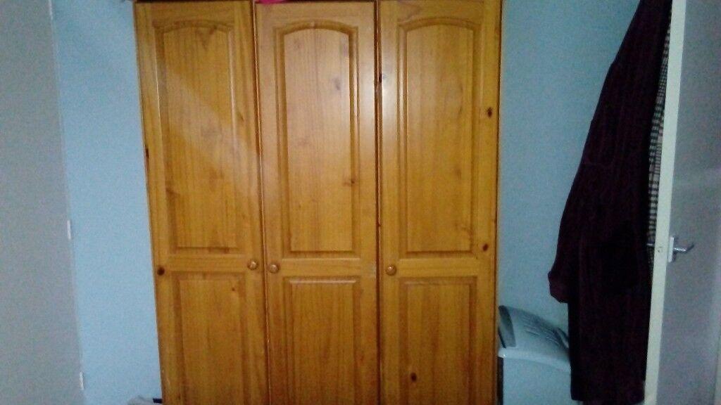 Three door pine wardrobe