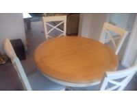 Solid wood dining table and four chairs.