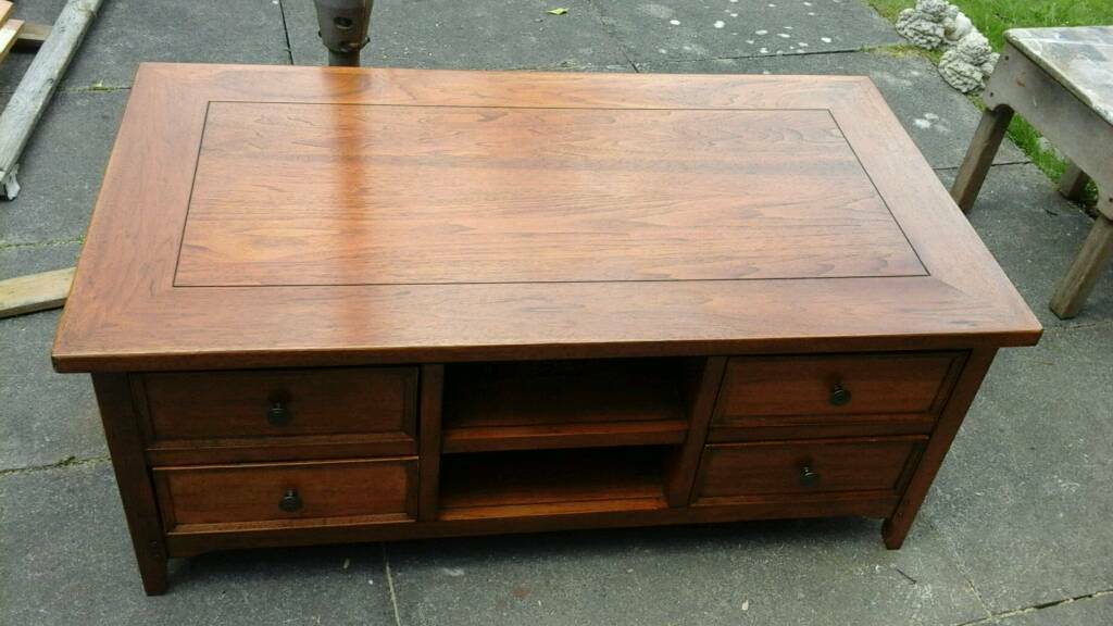 solid oak heavy coffee table, 8 drawers marks and spencers quality