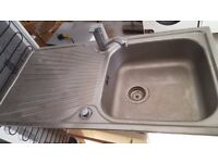 Stainless steel kitchen sink and tap in good condition