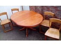 Stag round extending table and 4 chairs ( that don't match, will split) . House move forces sale.