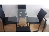 Designer glass dining table and 4 leather chairs