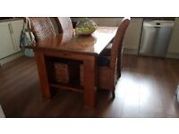 Dining table with 6 rattan chairs