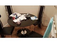 Round black glass dining table & 4 high back silver & black leather chairs