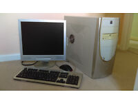 PC in tower case with 17 inch monitor, keyboard and mouse.